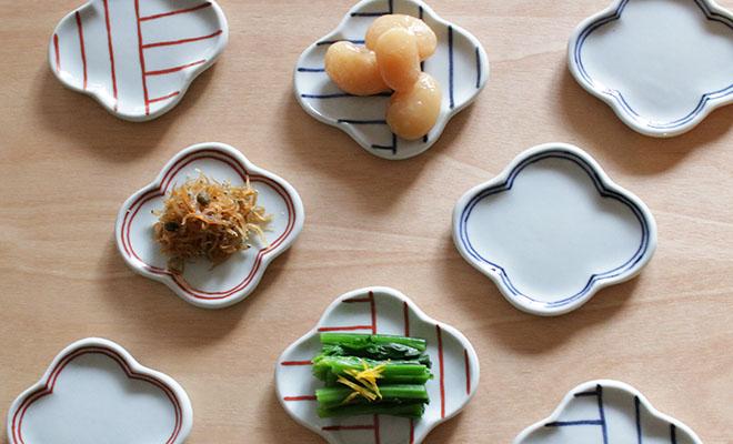 日下華子 九谷焼 モッコ豆皿に料理が盛られて食卓に並べられている画像